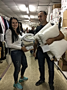 New immigrants receive bedding.png
