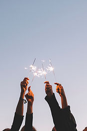 crop-hands-with-sparklers_23-2147784716.