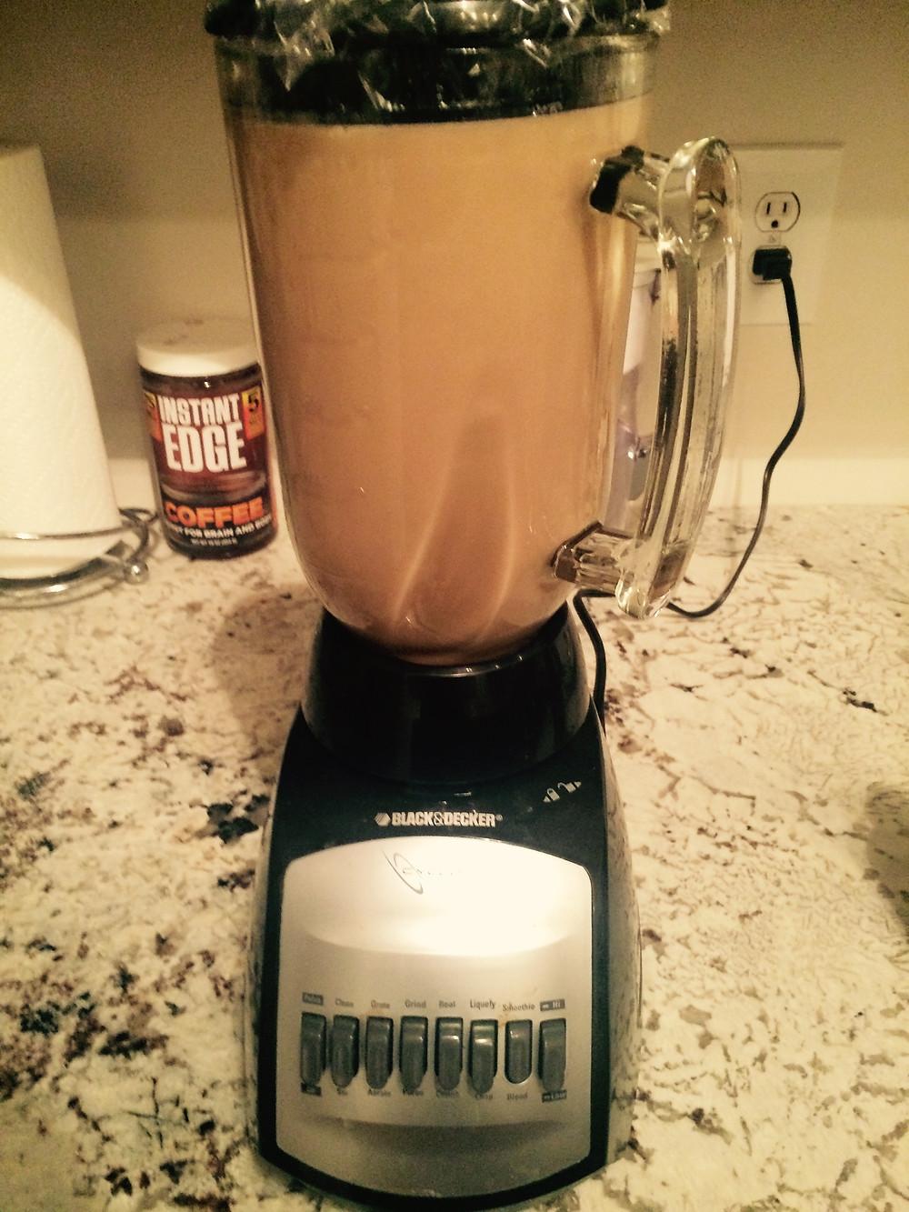 chocolate blending pili nut milk.jpg
