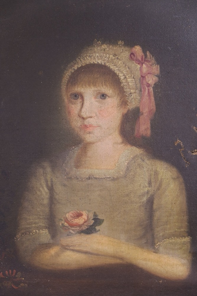 Portrait of a child holding a rose