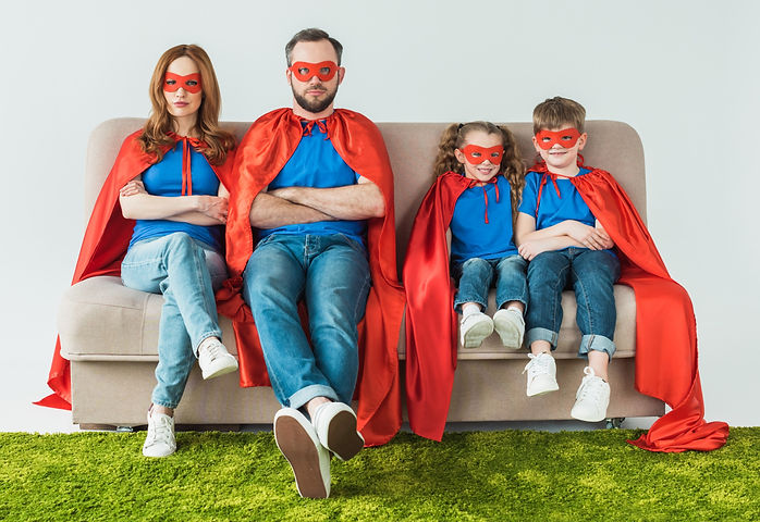 family%20in%20superhero%20costumes%20sitting%20with%20crossed%20arms%20and%20looking%20at%20camera%2