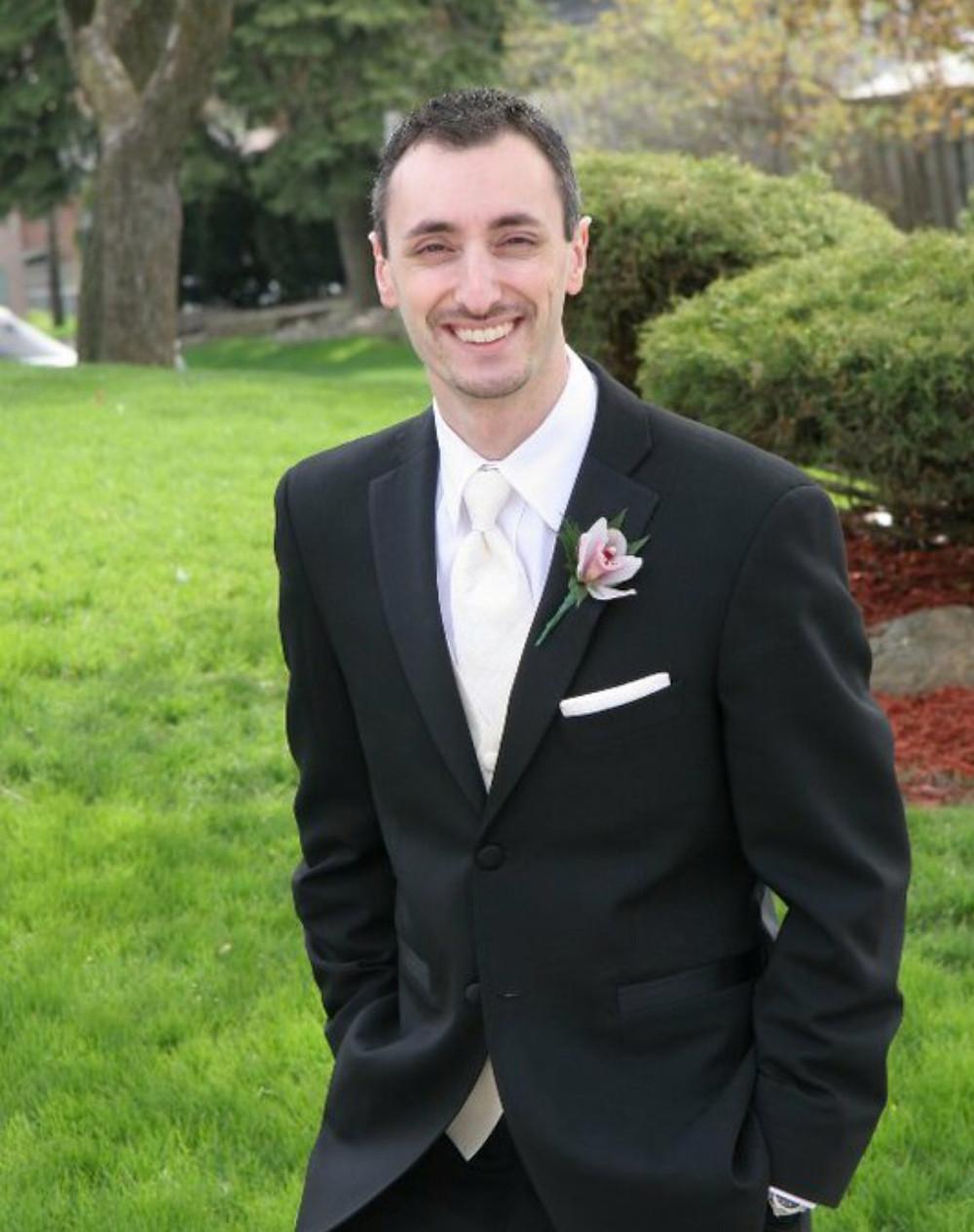 Mark Daher in a suit