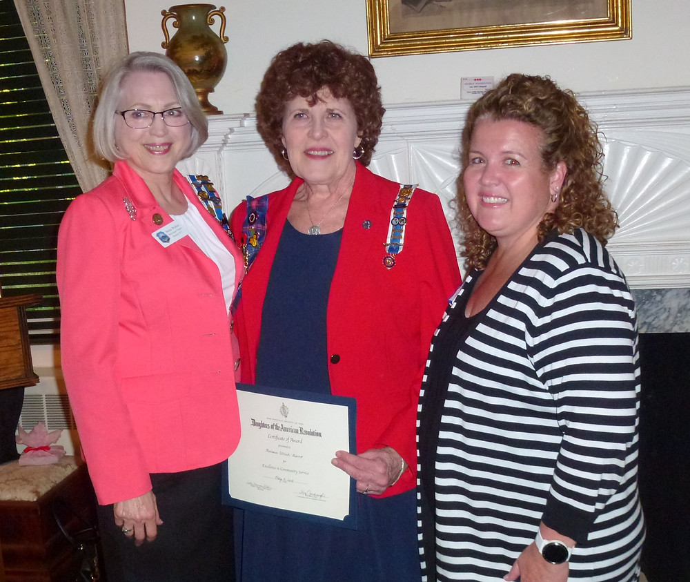 Pictured left to right: Helen Walker, Melzingah Chapter Regent; Barbara Ulrich-Giaimo, Award Recipient; Heather Sulca, Community Service Chairman