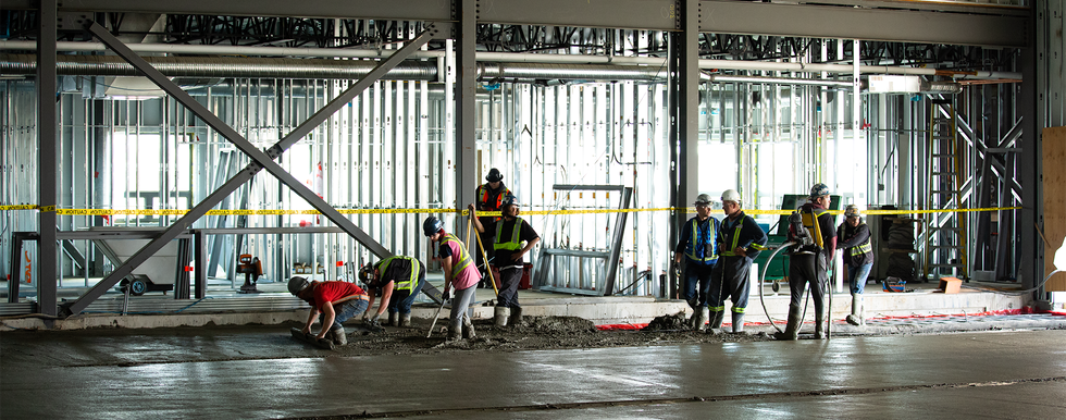 Concrete being poured in the WID shop area