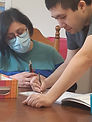 Photo of people doing a writing activity.