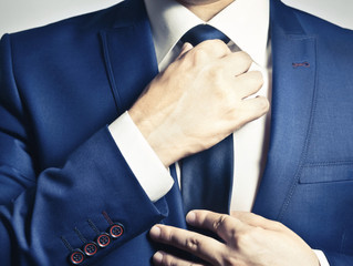 On Suit Coats, Ties & Welcome Signs: Why Small Courtesies Matter