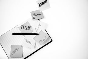 grayscale-photo-of-lined-paper-notebooks