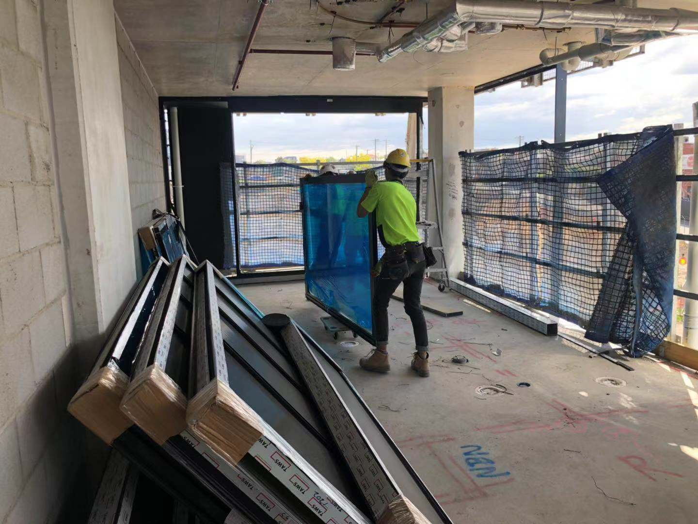 Carrying Glazing carefully on the worksite