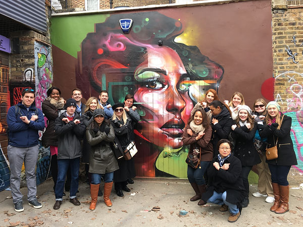 Xavier London MBA in front of Brick Lane Graffiti
