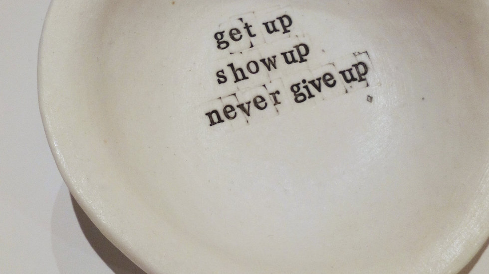 'Get up, show up, never give up'