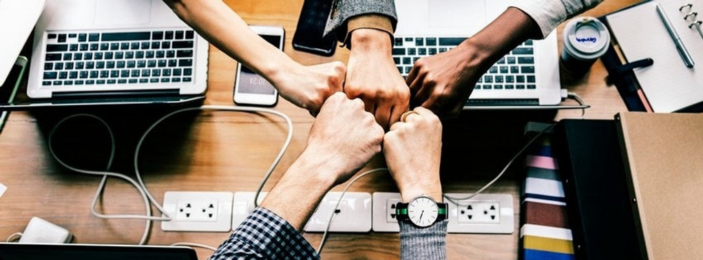 group-hand-fist-on-business-meeting.jpg