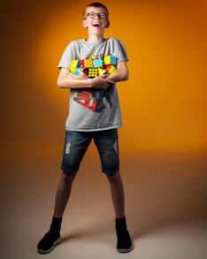Boy with rubix cubes by Clifton Photographic
