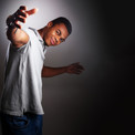 Teenage boy with open arms by Clifton Photographic