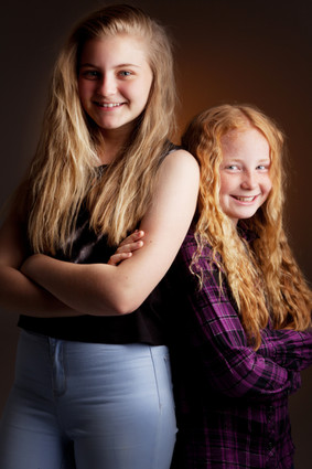 Portrait of sisters smiling by Clifton Photographic