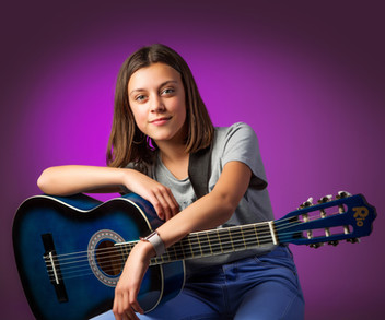 Teenage girl with blue guitar by Clifton Photographic