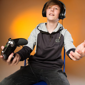 portrait of boy playing computer games by Clifton Photographic