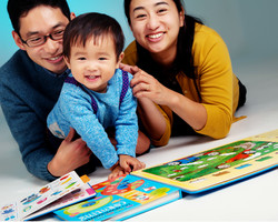 Parents read with young child photographed by clifton photographic
