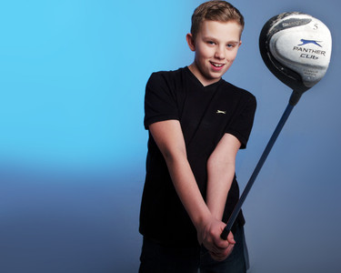 Portrait of young golfer by Clifton Photographic