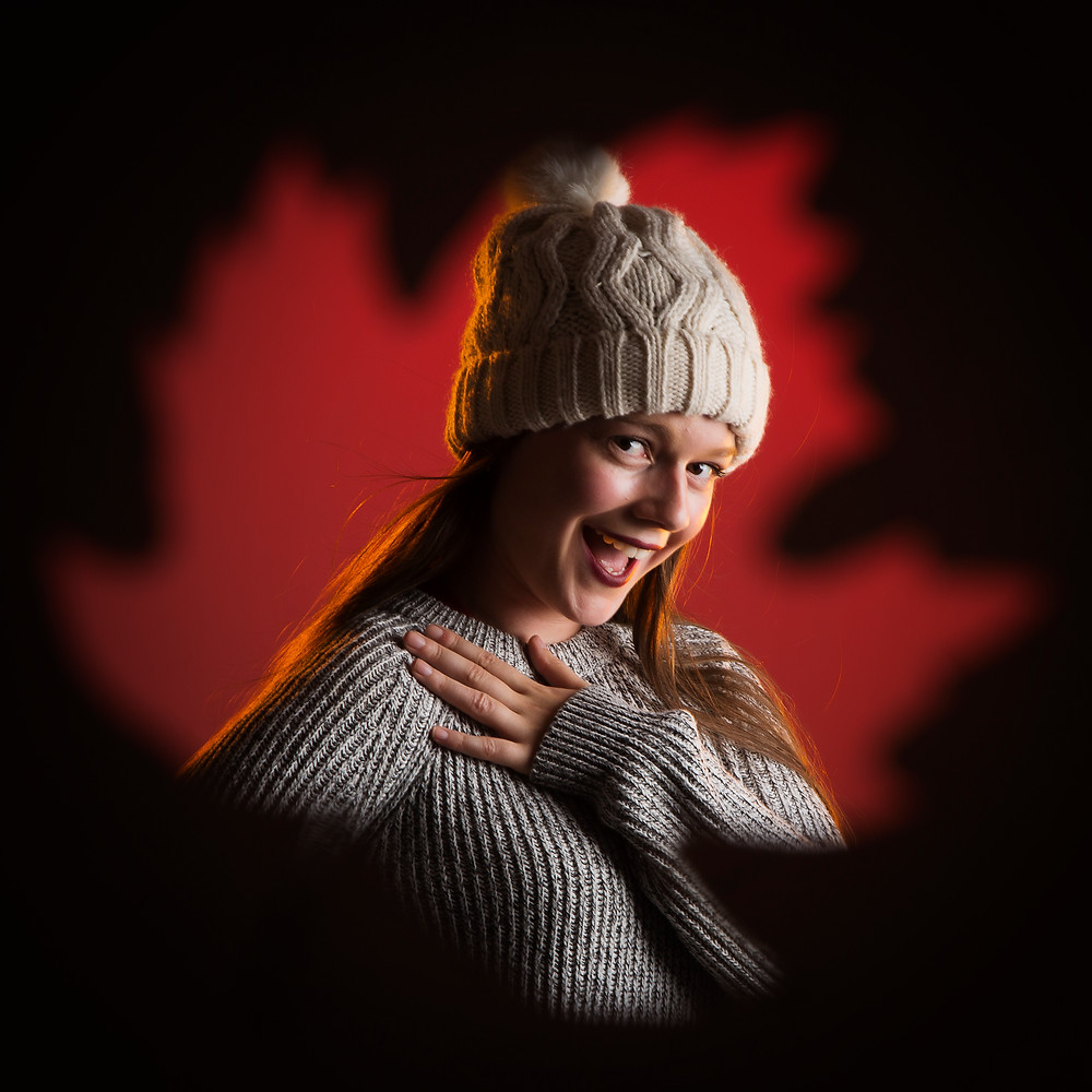 Professional portrait of girl wearing knitted hat