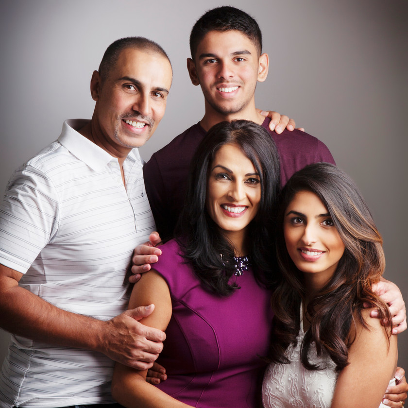 Tradition family portrait with coordinating outfits by clifton photographic