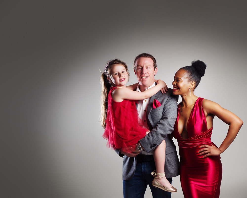 Family wearing coordinating red and grey outfits by clifton photographic
