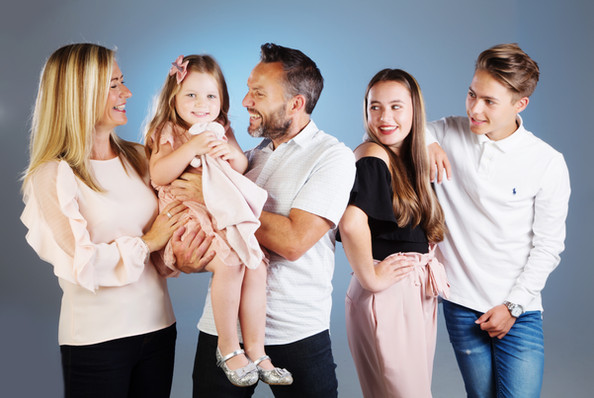 A family photograph with coordinating outfits by clifton photographic in bristol, uk