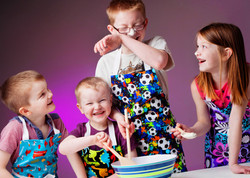 Children having fun baking cake photographed by clifton photographic