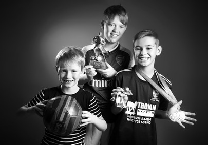 Three football boys by Clifton photographic