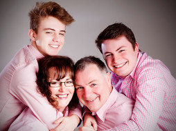 Portrait of family wearing pink shirts