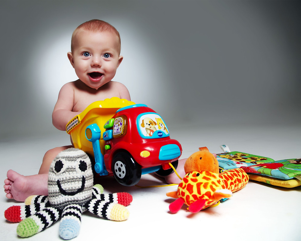 baby playing with paw patrol toys by Clifton Photographic