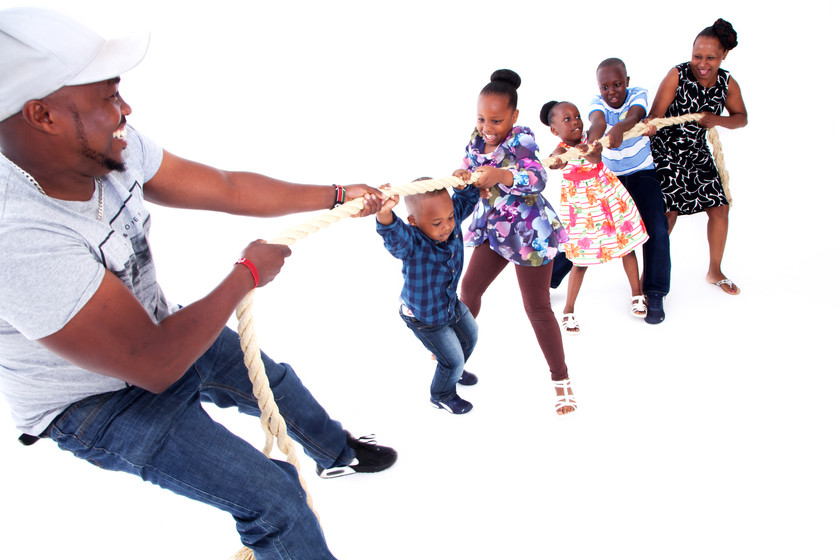 Family playing tug of war photographed by clifton photographic