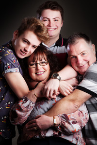 Portrait of family cuddling by Clifton Photographic