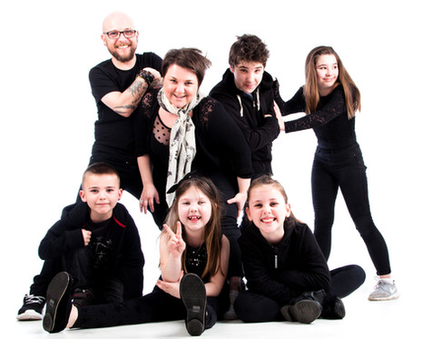 Family with matching black outfits by Clifton Photographic in bristol