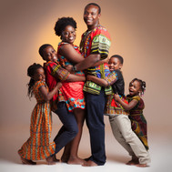 Family portrait in colourful, traditional clothes by clifton photographic