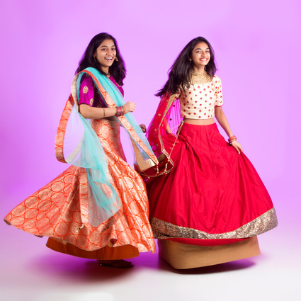 Teenage girls in tradition Indian clothes by Clifton Photographic