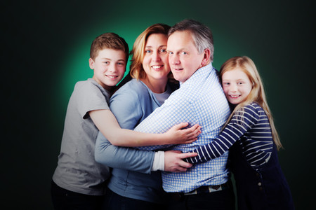 Family portrait with green background by clifton photographic