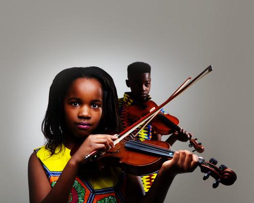 Photograph of siblings playing violin