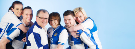 Family portrait wearing football strip by Clifton photographic