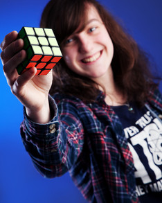 girl with rubix cube by Clifton Photographic