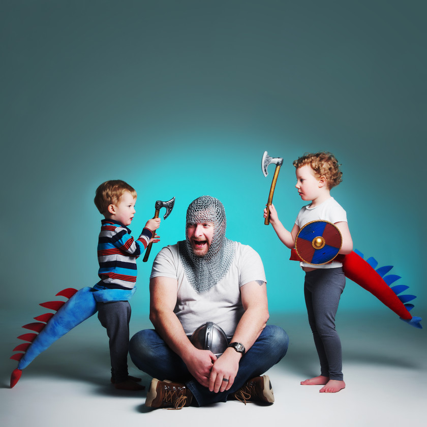 Children with dinosaur tails playing with dad photographed by clifton photographic