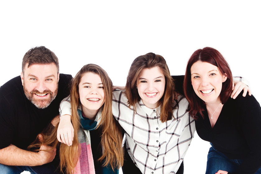 High-key family portrait photographed by clifton photographic