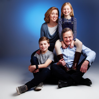 Family portrait with blue outfits by clifton photographic in bristol, uk