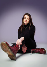 Portrait of teenage girl wearing Doc Martin boots by Clifton Photographic