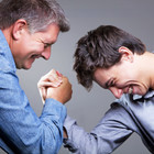 Father and son arm wrestling by Clifton Photographic