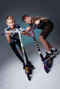 Boys on scooters by Clifton Photographic