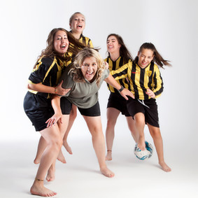 Mother and daughters who love football by Clifton Photographic