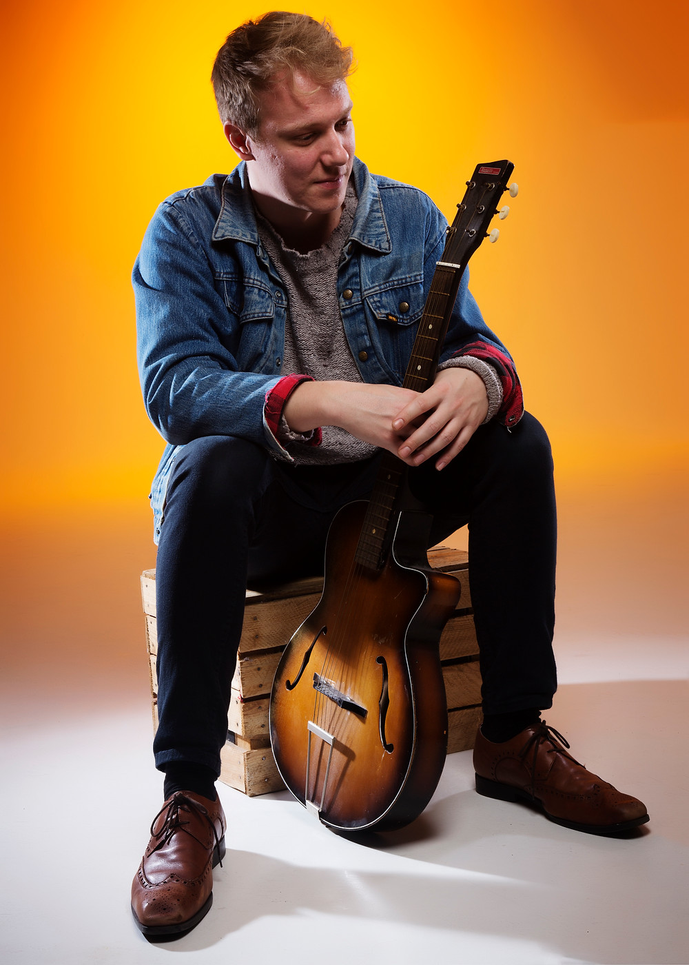 professional portrait of man with a guitar