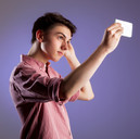 Teen boy taking a selfie by Clifton Photographic