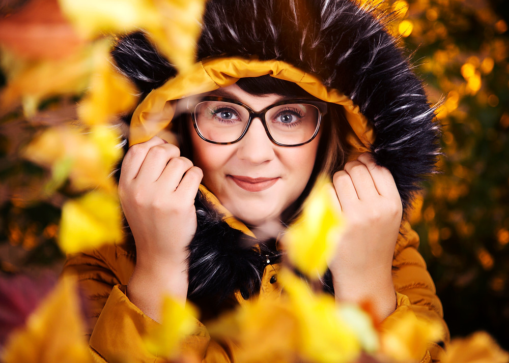 Close up of woman wearing a fluffy hood