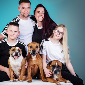 Family portrait in matching outfits by Clifton Photographic